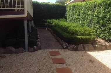 rock pathway with trimmed plants